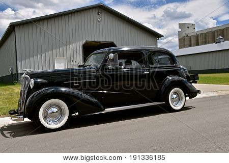 MOORHEAD, MINNESOTA, June 15, 2017: The black 1937 car is a Chevrolet, colloquially referred to as Chevy and formally the Chevrolet Division of General Motors Company, is an American automobile division of the American manufacturer.