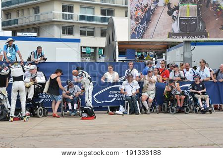 LE MANS FRANCE - JUNE 11 2017: Fabien Barthez former french goalkeeper and racer gives the autograph to fans Weighing administrative and technical checks of the race cars
