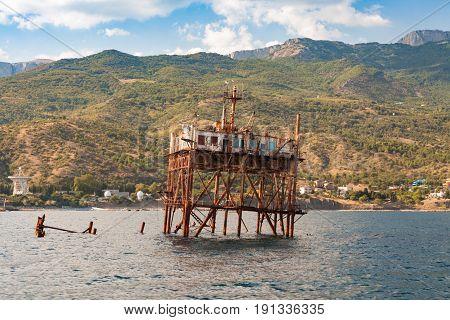 Southern coast of the Crimea. Black Sea. Settlement Simeiz Katsiveli. An old marine retro platform for exploring the ocean