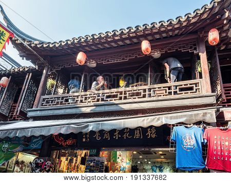 Shanghai, China - Nov 4, 2016: Around Yu Yuan (Yu Garden) - An old residential building with architectural structures designed in the traditional Chinese styling. Upper floor converted into a modern-day tea house.