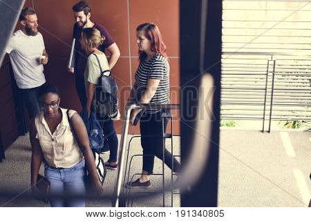 People Talking at Stairway During Break Time