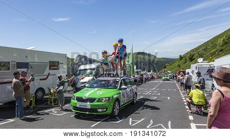 Pas de Peyrol France - July 62016: The Family Skoda during the passing of the Publicity Caravan on the road to Pas de Pyerol (Puy Mary) in Cantalin the Central Massif during the stage 5 of Tour de France on July 6 2016. Skoda provides the official car of