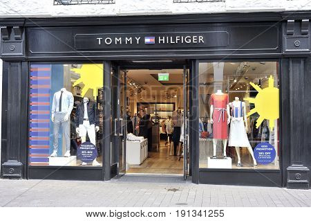 Shop Street, Galway, Ireland June 2017, Tommy Hilfiger Store, Girl Shoping.
