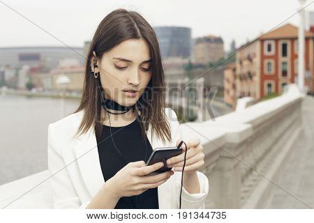 Young Woman Using Her Smart Phone.