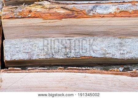 Neatly Stacked Horizontal Firewood From Alder Wood Backgrownd