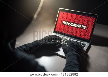 Male hacker hacking into computer operating system. Internet security malware virus Trojan ransomware system breached concept