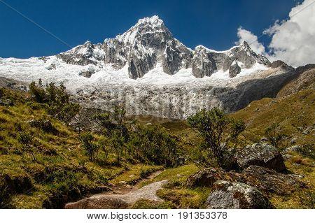 One of the snow-covered peaks of Cordillera Blanca iat Santa Cruz Trek in Peru