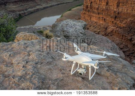 MOAB, UT, USA - MAY 7, 2017:  DJI Phantom 4 pro drone is ready to take off in the canyon of Colorado River for sunrise photography.