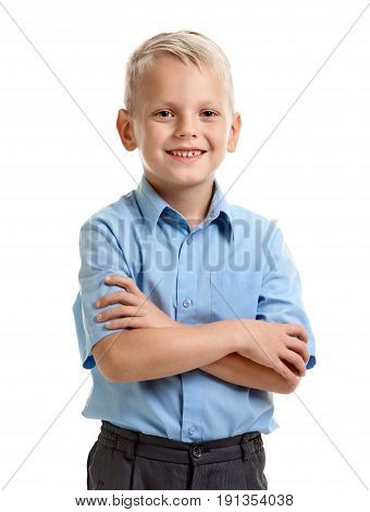 Portrait of happy smiling cute schoolboy with crossed hands