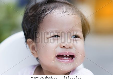 Sweet Beautiful baby girl crying refuse to eat is not hungry