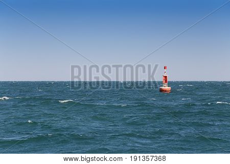 Signal buoy in the seaWarning symbols for marine navigation.