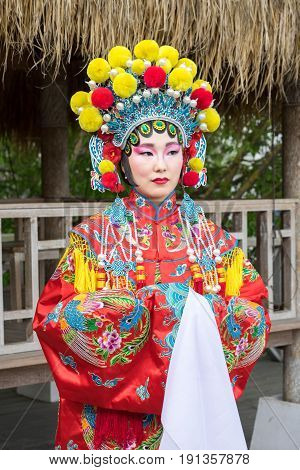 Portrait Of Beautiful Chinese Girl In Traditional Chinese Dress