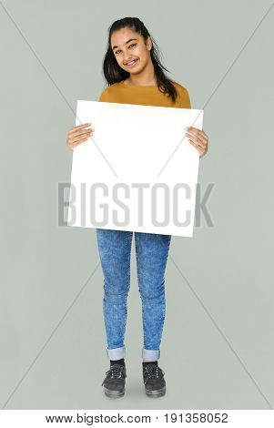 Indian Ethnicity Smiling Girl Standing and Holding Placard