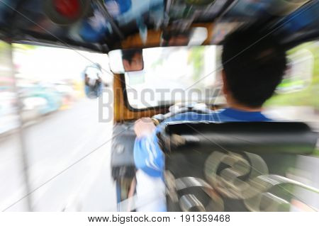 chauffeur of TUK TUK Car in shooting techniques photoconcept of tourism and transportation.