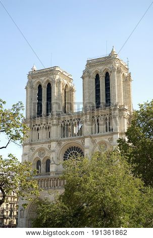 Afternoon image of Notre Dame de Paris often known simply as Notre Dame Cathedral. The structure is a Gothic cathedral on the eastern half of the Île de la Cité in Paris France. Notre Dame de Paris (French for