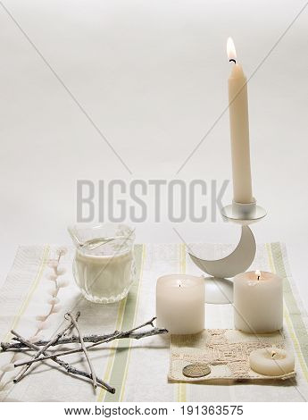 Wiccan ritual altar for Imbolk picture. Candles burning