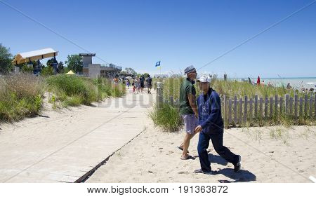 Grand Bend Ontario, Canada - July 02, 2016: Unidentified People In The Beach Of The Lake Grand Bend