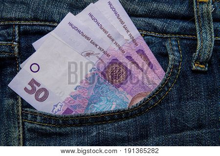 Ukrainian Money In A Pocket Of Blue Jeans