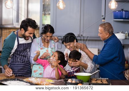 Happy multi-generation family enjoying together in kitchen at home