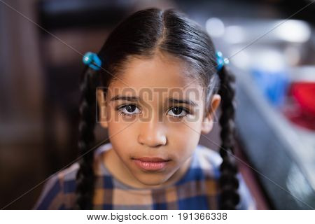 Portrait of cute girl in kitchen at home