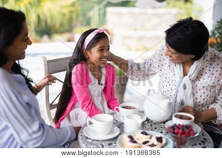 Smiling multi-generation family having breakfast together at home