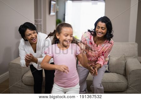 Happy multi-generation family dancing together at home