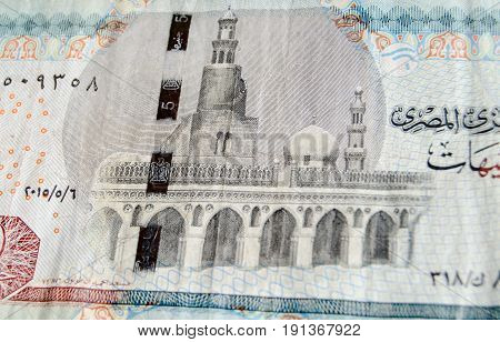 The mosque of Ibn Tulun in Cairo depicted on the reverse of a five pound banknote from Egypt. Used banknote photographed at an angle.