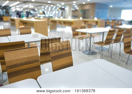 Interior Of White Table And Wooden Table On Food Court In Shopping Mall.