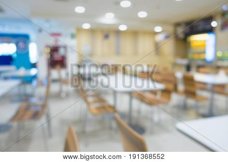 Blur Of White Table And Wooden Table On Food Court In Shopping Mall.