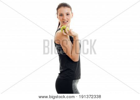 Skinny young fitness Lady eats an Apple and smiling isolated on white background