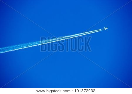 Passenger Airplane In The Sky On Sunny Cloudless Day