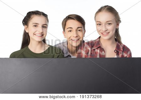 Smiling Teenagers With Blank Banner Isolated On White