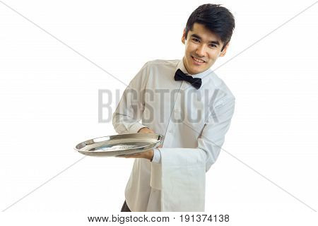 hilarious amazing waiter smiling and holding a tray with a towel isolated on white background