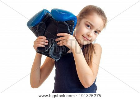 Portrait of a little girl who holds boxing gloves close-up isolated on white background