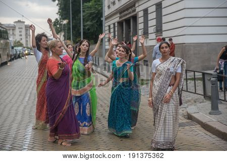 SofiaBulgaria - September 10 2016: The cart festival called 'Ratha Yatra' in Sofia september 10 2016. Priests throw fruits offered to the deities to the people lifting up their hands to catch