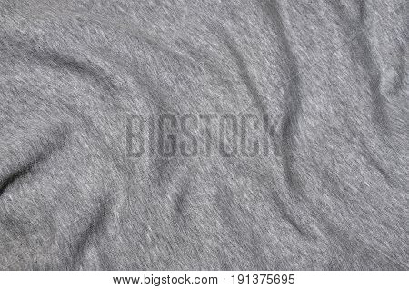 Close-up Of Rumpled Heater And Knitted Sport Jersey Or Hoodie Fabric Textured Cloth Background With