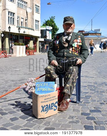 Uzhgorod,ukraine -may 09, 2017: War Veteran Begging Money For Surgery Of His Wife In Uzhgorod, Ukrai