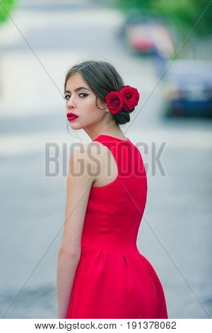 Girl In Fashionable, Red Dress Walking On Road