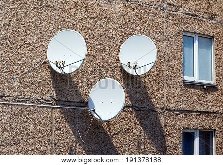 Three Satellite Antennas On The Home