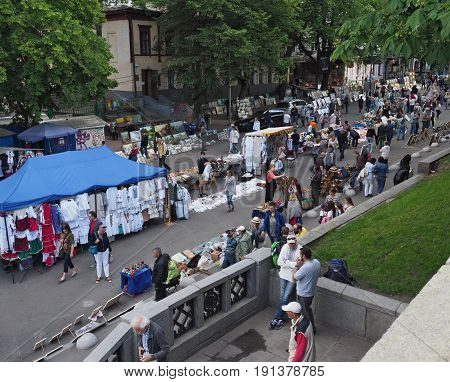 KIEV - UKRAINE - MAY, 2017: Vladimirskaya street on the Day of Kiev. People walk around the tents with Ukrainian souvenirs. Street lined with paving stones, chestnuts - a symbol of Kiev