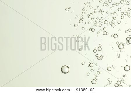 Beautiful champagne bubbles flows over a gray surface