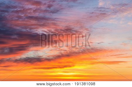 Abstract bright sky with clouds at sunset