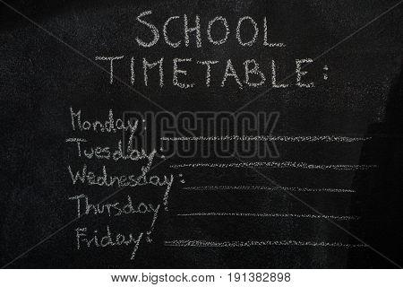School timetable drawn with chalk on blackboard. Education, school concept