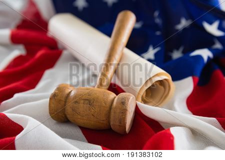 Close-up of gavel and legal document arranged on American flag