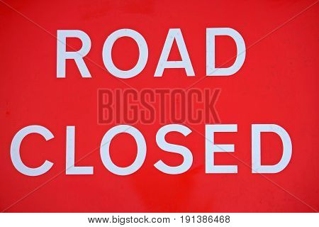 close up of a road closed sign