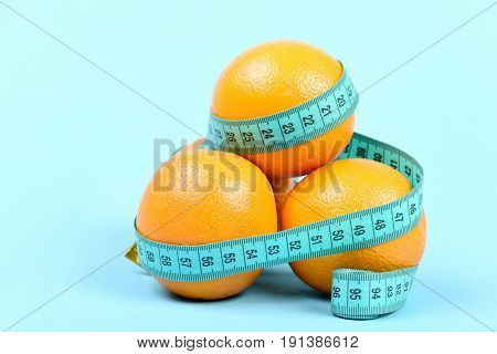 Pile Of Oranges Wrapped Around With Cyan Tape For Measuring