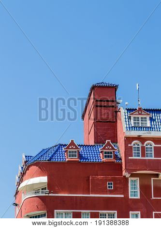 Red Plaster with Blue Tile Roof in Curacao