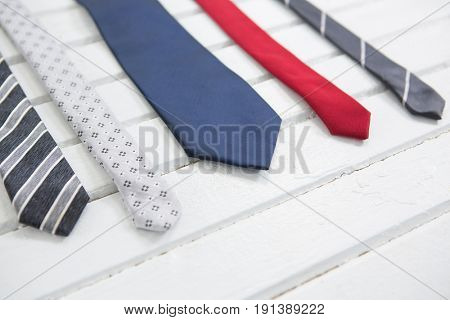 High angle view of multi colored neckties on wooden table