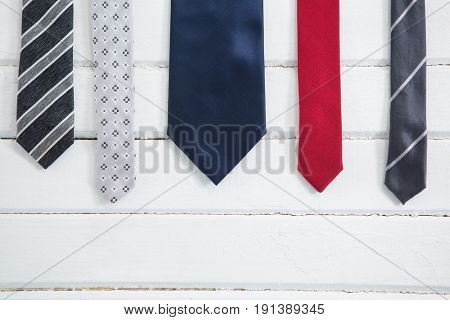 Close up of multi colored neckties on wooden table