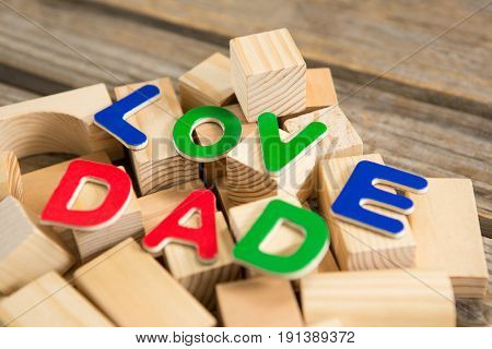 Close up of love dad text on wooden blocks at table